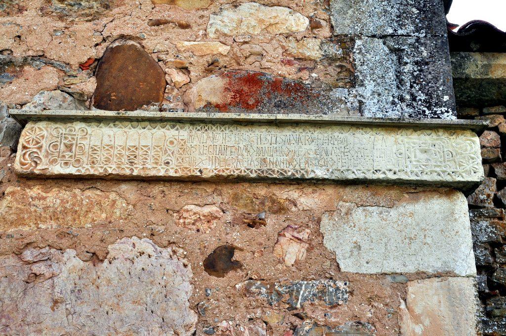 Lápida mozárabe fundacional en honor de San Adrián y Santa Natalia, fechada en el año 920. Está adornada con numerosos signos apotropaicos.
